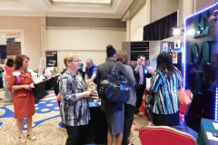 Attendees gather at exhibits for door prizes